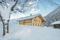 Berghaus Gauertal mit Blick auf die 3 Türme im Winter (c) Patrick Säly (Montafoner Hof)