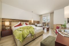 Doppelbett in der JuniorSuite (c) Jan Hanser mood photography (alpina zillertal)
