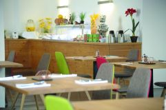 Frühstücksbereich adeo ALPIN Hotels