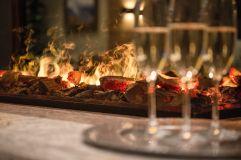 Kaminfeuer im Hotel Alpina Kössen