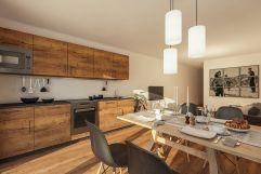 Küche mit geräumigen Essbereich im Carpe Solem (Alps Residence)