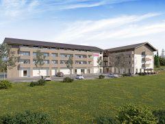 Visualisierung Hotelansicht mit Parkplatz (COOEE alpin hotel Bad Kleinkirchheim)