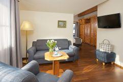 Wohnbereich in der Juniorsuite (c) Heimplätzer Werbefotografie (Concordia Wellnesshotel & Spa)